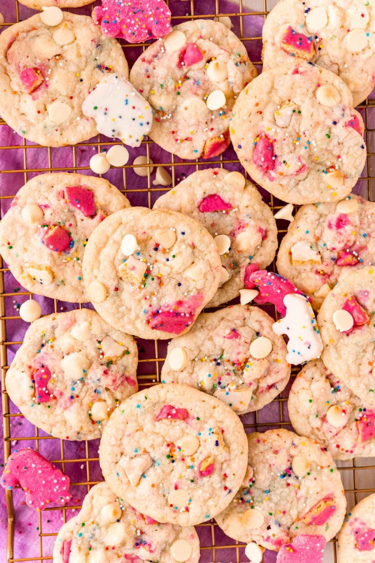Overhead photo of a bunch of sugar cookies with circus animal cookies on a cooling rack.