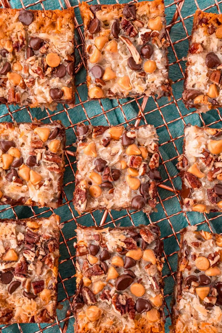 Overhead photo of sliced 7 layer bars on a copper wire rack.