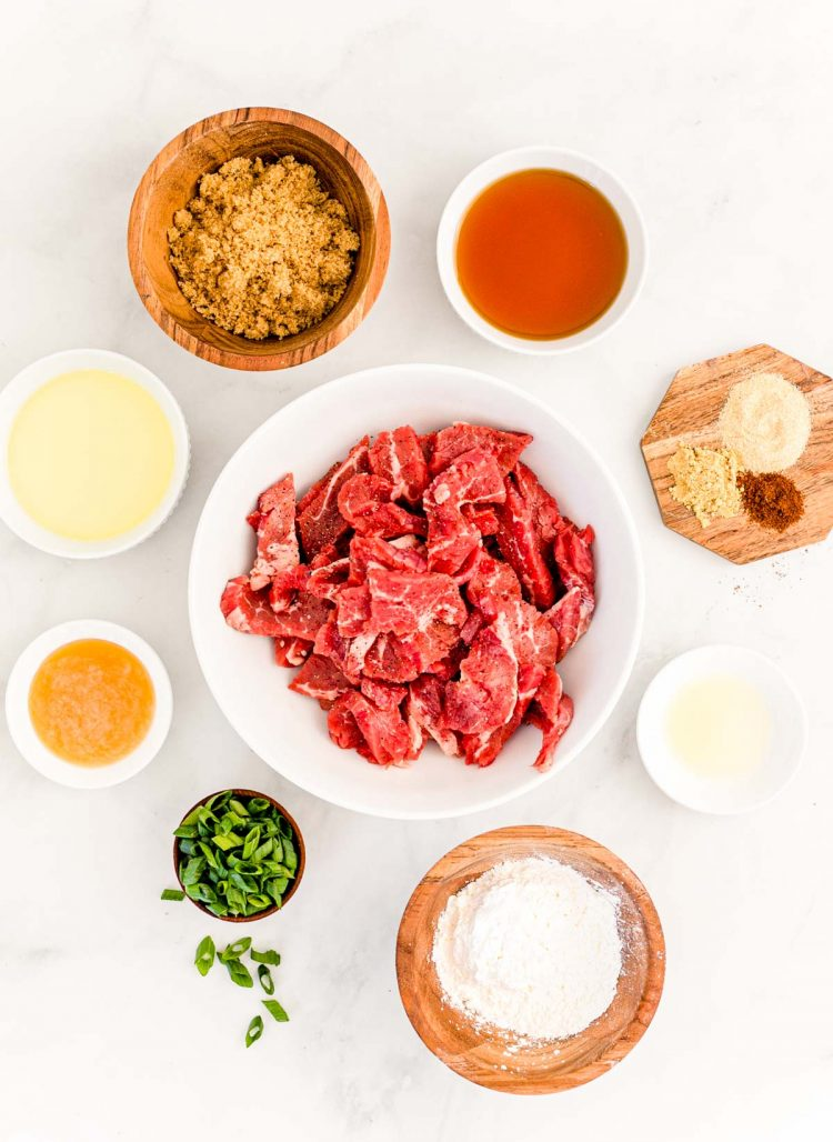 Overhead photo of ingredients prepped to make Mongolian beef on a white counter.