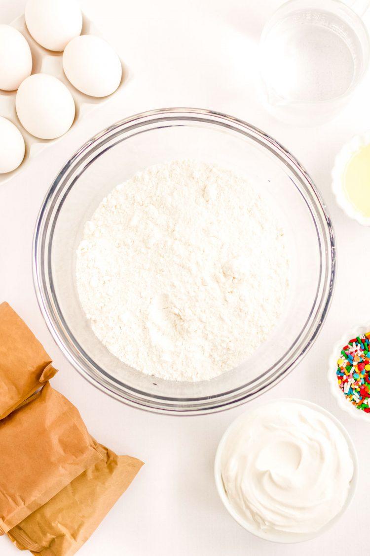 Ingredients to make rainbow jello poke cake.