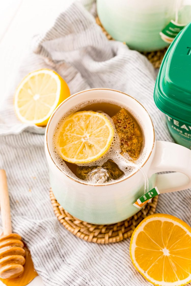 Starbucks medicine ball tea in a white and teal ombre mug.