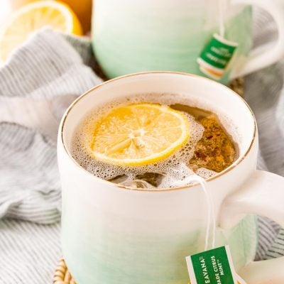 A mug filled with a homemade Starbucks medicine ball tea.