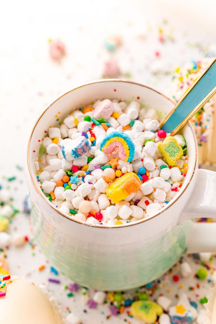 Close up photo of white hot chocolate with lucky charms marshmallows.
