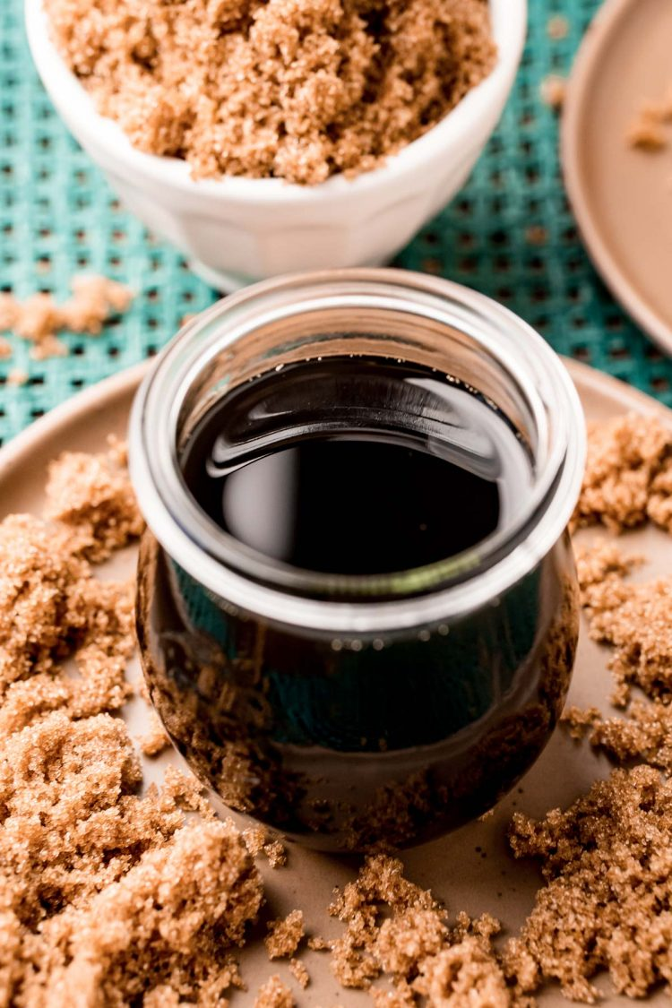 Close up photo of a jar with brown sugar simple syrup in it.