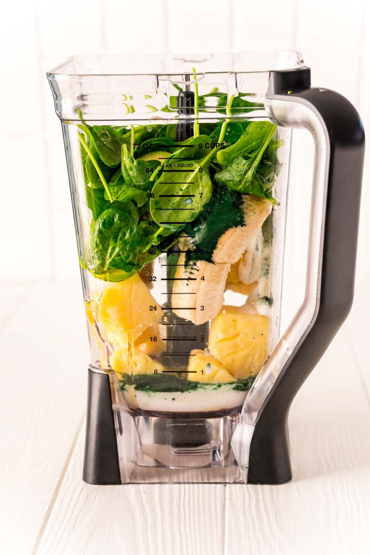 Ingredients to make a green smoothie in a blender.