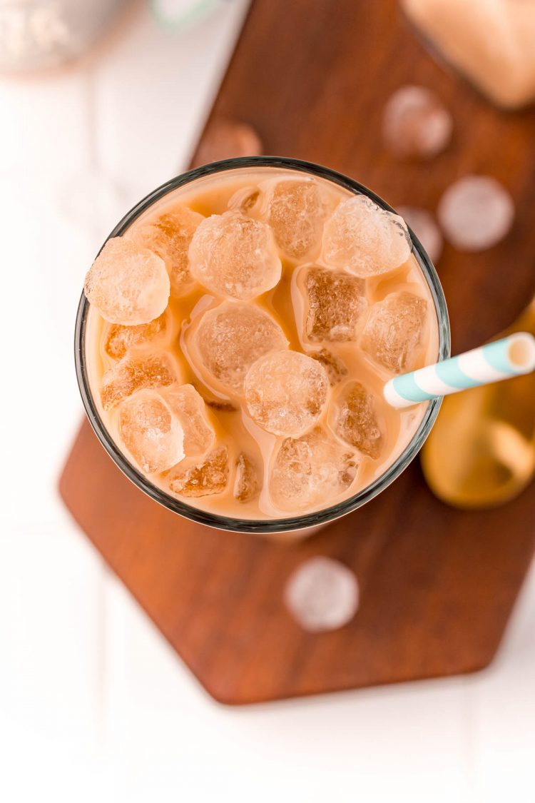 Overhead photo of a glass with an iced latte in it.