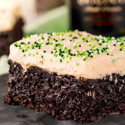 Close up photo of chocolate irish cream cake on a black plate.
