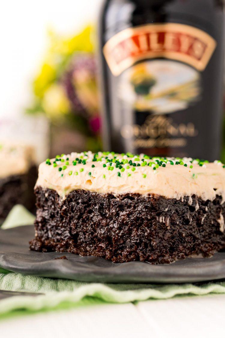 Close up photo of Irish cream cake on a gray plate.