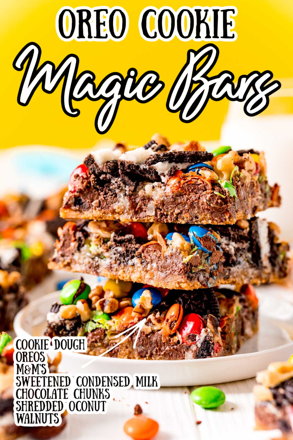 These Oreo Magic Bars have a refrigerated cookie dough base and are overflowing with Oreo cookies, chocolate chunks, coconut, nuts, and M&M's for a rich, tasty, and easy dessert! via @sugarandsoulco