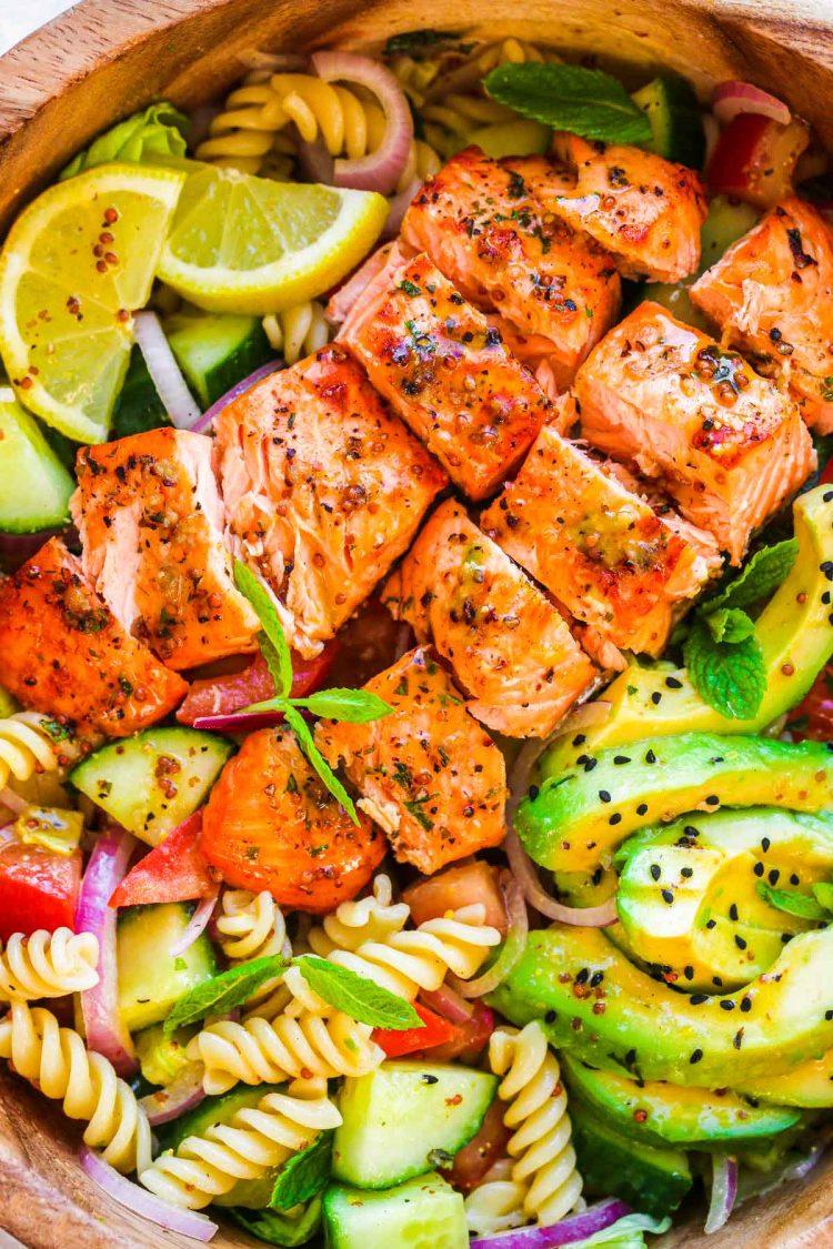 Close up photo of a salmon pasta salad.