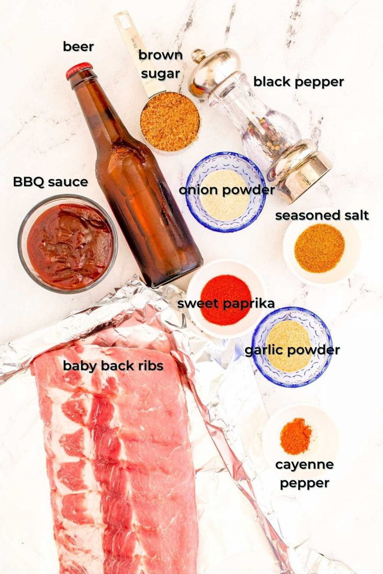 overhead photo of ingredients to make bbq baby back ribs on a marble table.