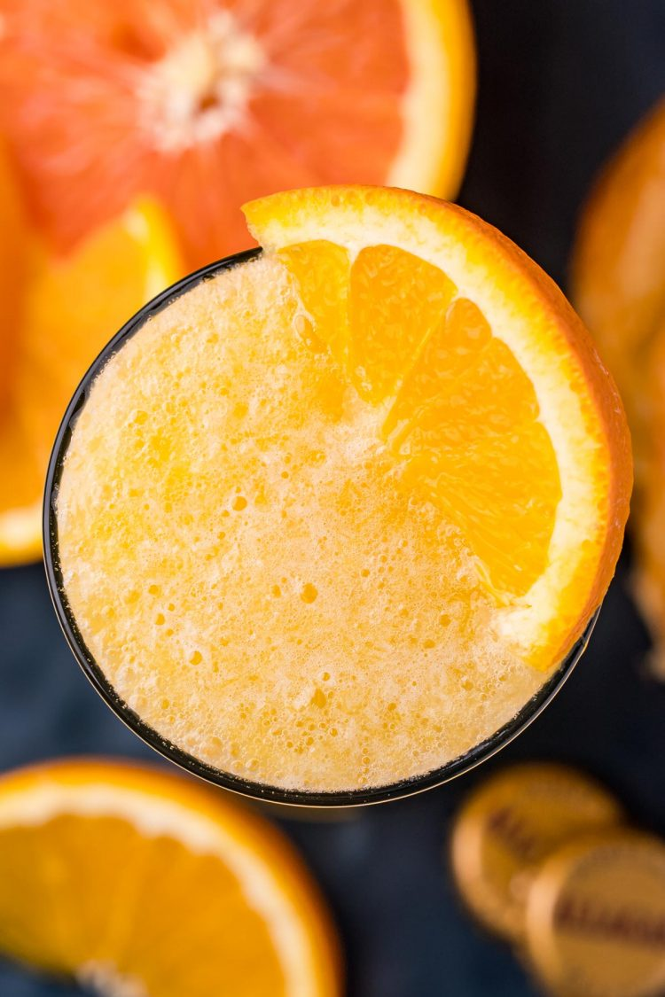 Overheard photo of a beermosa topped with a slice on orange.