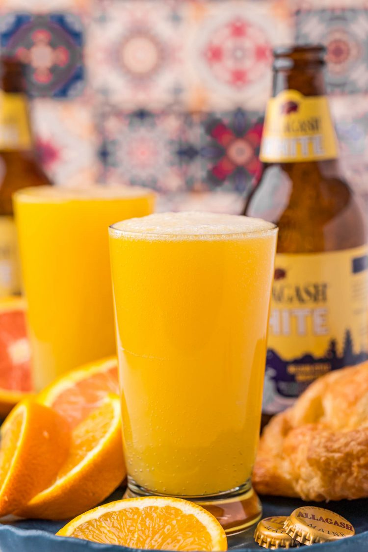 Straight on photo of a beermosa with a bottle of Allagash White in the background.