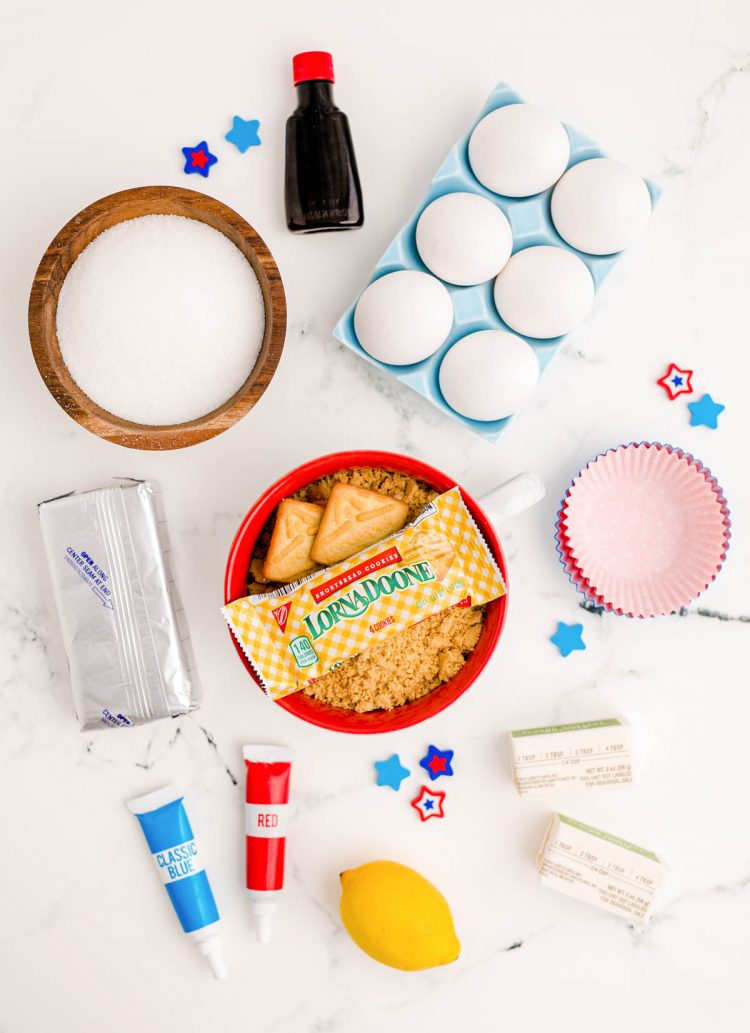 Overhead photo of ingredients prepped to make mini 4th of july cheesecakes.