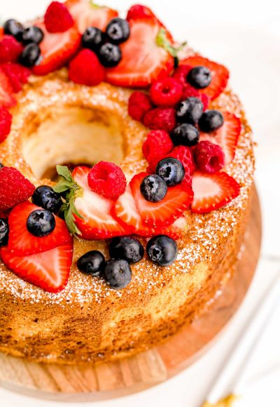 Close up photo of angel food cake topped with fresh berries.