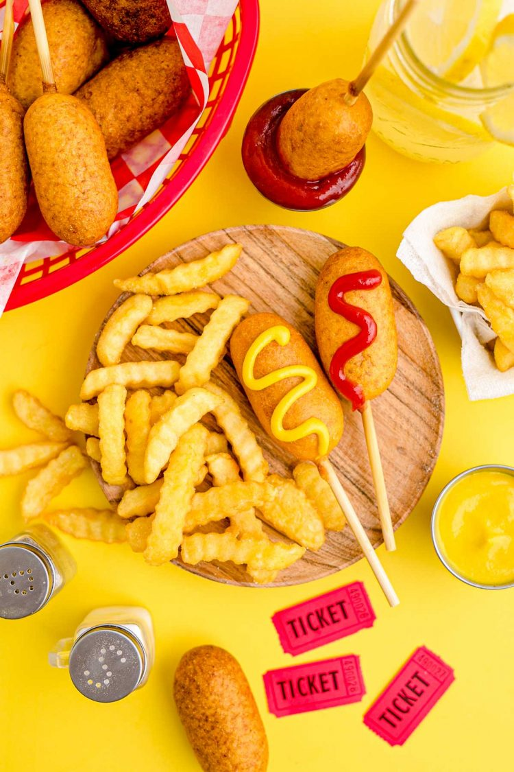 These Mini Corn Dogs take half hot dogs, roll them in a sweet, cornmeal batter, and then deep fry to golden brown perfection! Great for a weekend snack, game day appetizer, or a quick lunch your kids will love!