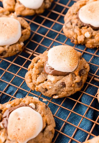 Close up photo of s'mores cookies on a copper wire rack.