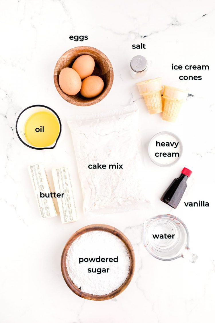 Ingredients to make ice cream cone cupcakes prepped on a white table.