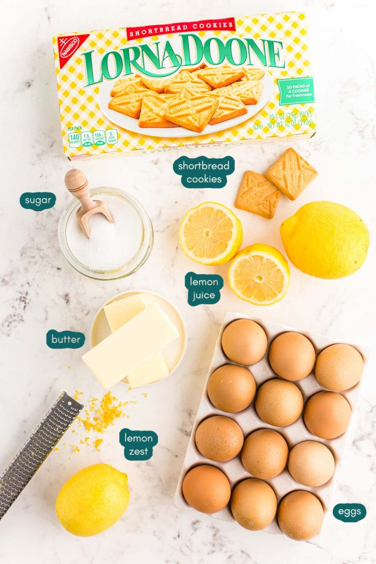 Overhead photo of ingredients to make a lemon tart on a marble counter.