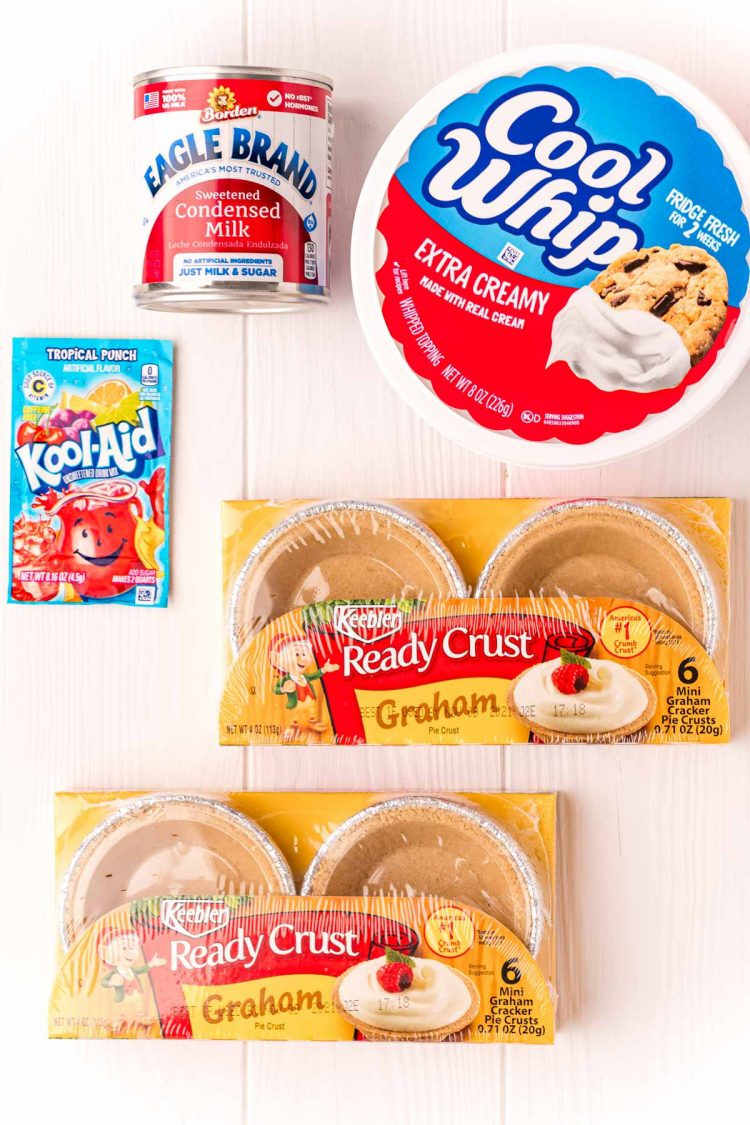 Overhead photo of ingredients needed to make kool-aid pie on a white table.