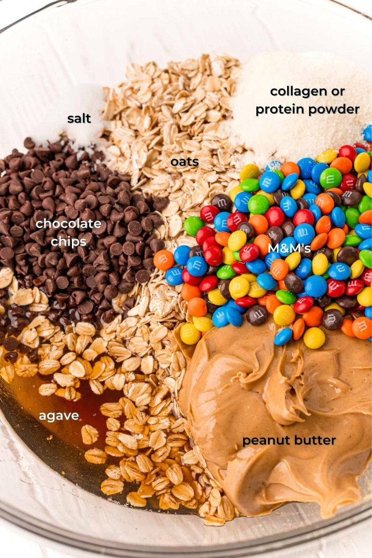 ingredients to make monster cookie balls in a mixing bowl.
