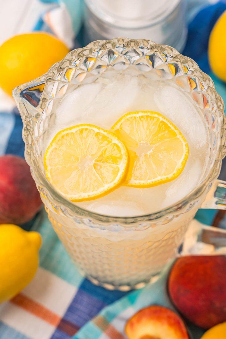Close up photo of a pitcher or peach lemonade.