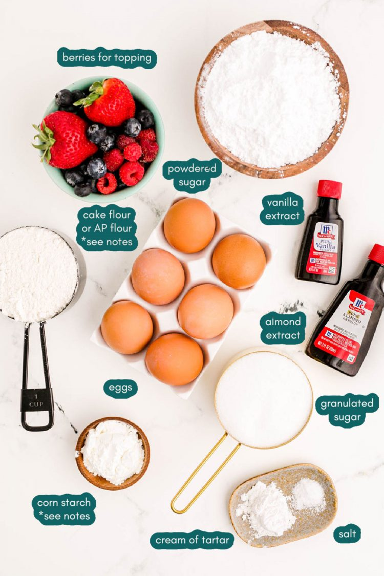 Ingredients to make angel food cake from scratch on a marble counter.