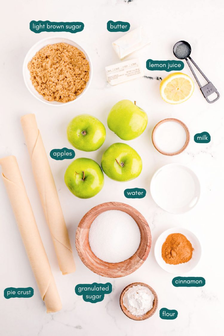 Overhead photo of ingredients used to make apple pie on a marble table.