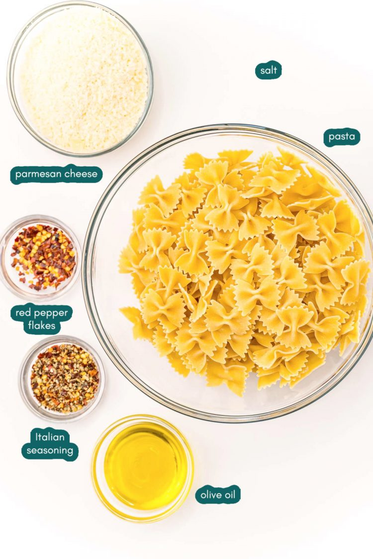 Overhead photo of ingredients to make pasta chips prepped on a white wood table.