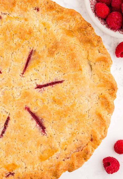 Overhead photo of a raspberry pie made with cream cheese pie crust.