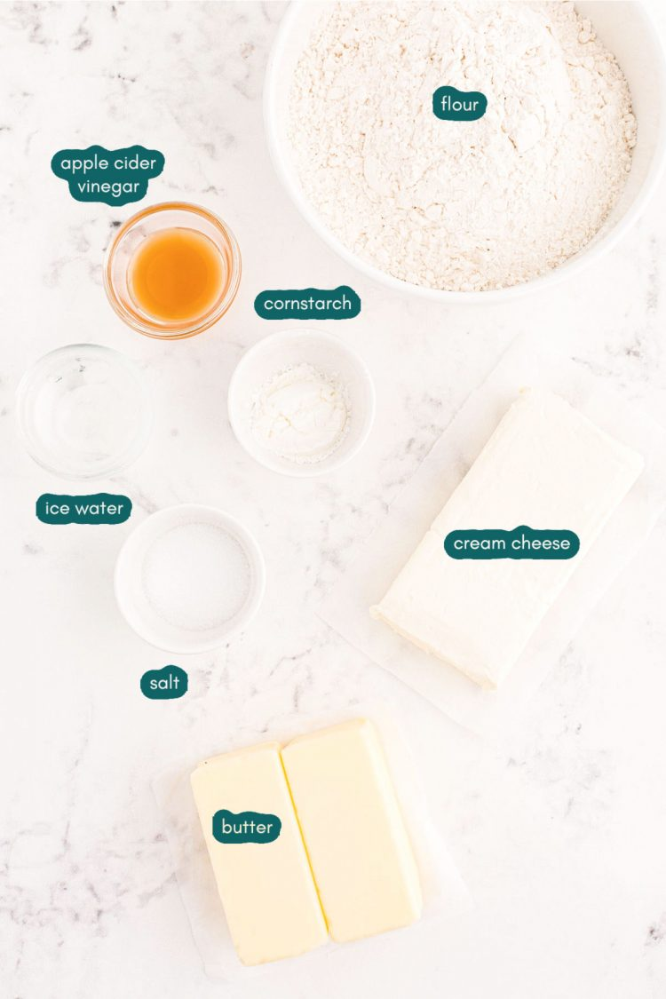 Overhead photo of ingredients used to make cream cheese pie crust prepared on a white marble surface.