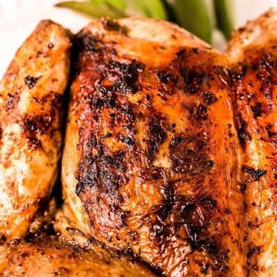 Close up photo of a spatchcock grilled chicken.