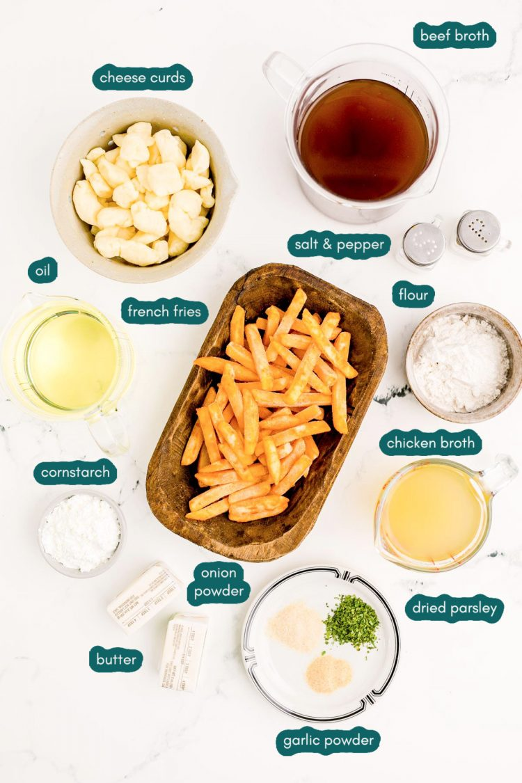 Overhead photo of ingredients to make poutine on a marble surface.