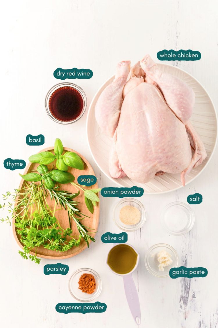 Ingredients to make spatchcock chicken on a marble surface.