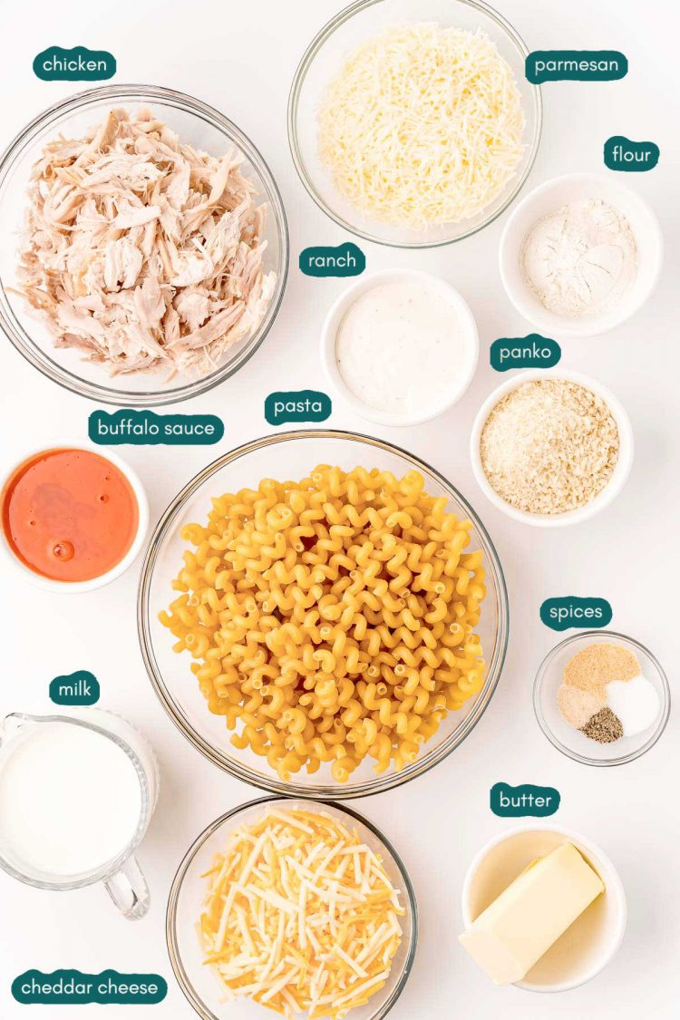 Overhead photo of ingredients prepped to make buffalo chicken mac and cheese on a white surface.
